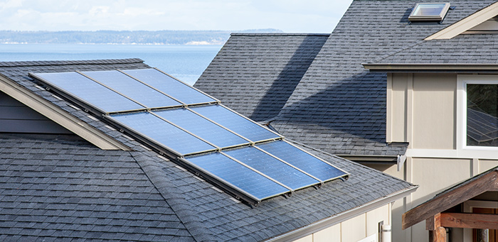 Solar panels on a residential roof to provide supplemental electricity.